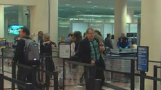 Questions raised about guns and airport security - Video