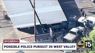 RAW: Police draw guns after pursuit ends in crash