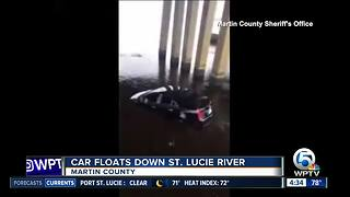 Car floats down St. Lucie River - Video