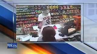 Green Bay Police release photos of liquor store armed robbery suspect