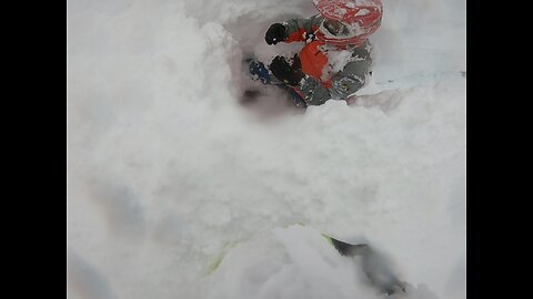 Deep Snow Swallows Up Snowmobile