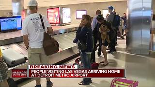 People visiting Las Vegas during mass shooting arriving home at Detroit Metro Airport - Video