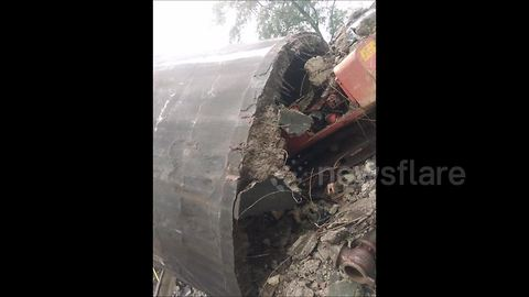 Water tank collapses and crushes digger in demolition fail