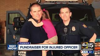 BBQ held for Phoenix officer injured in crash - Video