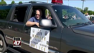 Flint airport officer stabbed in attack joins July 4 parade - Video