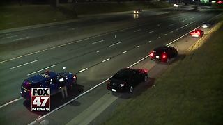 Police search Detroit highway for clues in linked shootings - Video