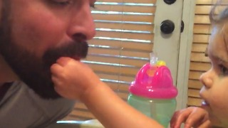 A Little Girl Feeds Her Dad While He Pretends To Be A Bird - Video