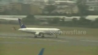 Plane lands safely after landing gear failure - Video