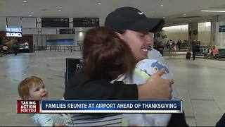 Families reunite at airport ahead of Thanksgiving