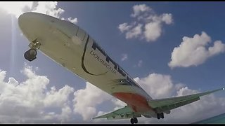 Plane Performs Scary Low Landing At St. Maarten Beach - Video