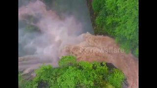 Drone captures powerful flash flood waterfall in China - Video