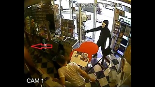 Dog Disarms Robber and Saves His Owner's Shop - Video