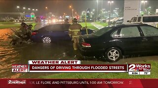 dangers of driving through flooded streets