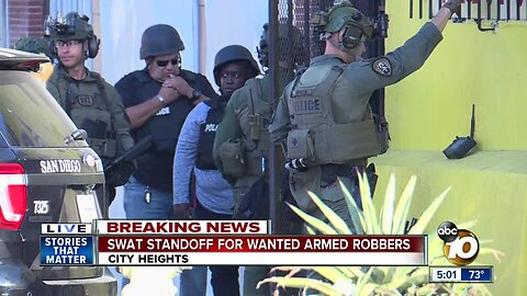 SWAT standoff for wanted armed robbers