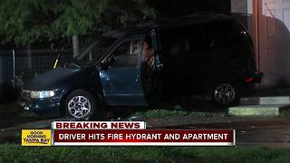 Driver hits fire hydrant and apartment - Video