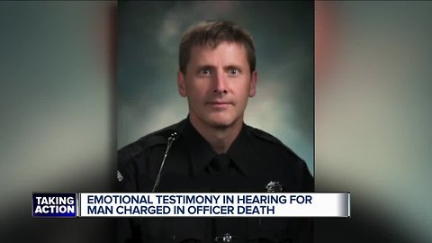 Enotional testimony in hearing for man charged in officer's death