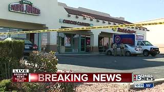 Woman shot in front of check cashing store - Video