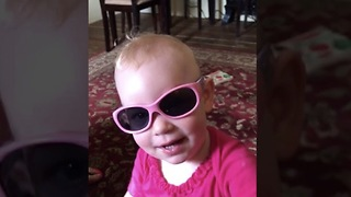 One Year Old Musician Jams on Harmonica
