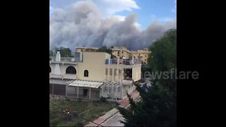 Holidaymakers watch smoke rise above Attica - Video