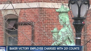 Baker Victory employee charged with 201 counts