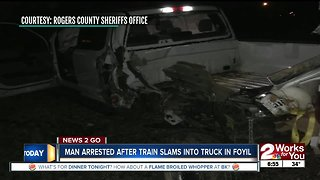Man arrested after train slams into truck