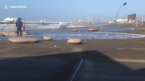 High Tide Surges Onto Boardwalk In Blackpool