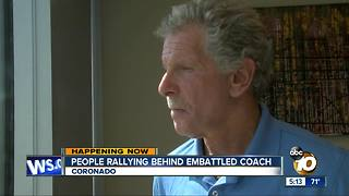 People rallying behind embattled coach - Video