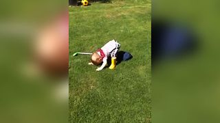 Cute Kid Adorably Fails At Golf - Video