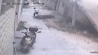 Scooter driver narrowly escapes being buried under collapsed wall - Video