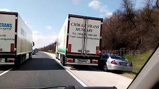 Road rage video shows 2 trucks bully a Mercedes - Video