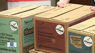 Girl Scouts deliver donated cookies