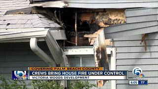 Crews bring house fire under control in Victoria Woods development