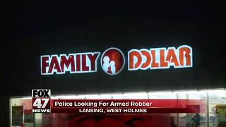 Lansing Police searching for armed robber - Video