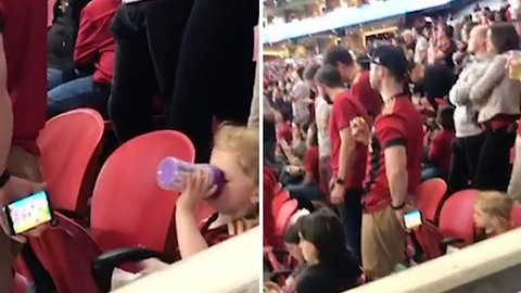 Football Fan Holds Phone Behind His Back So Daughter Can Watch Cartoons