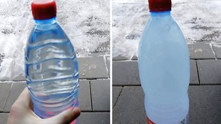 Amazing Moment Shows Water Instantly Freezing In Bottle - Video