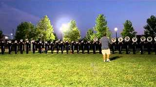 Marching Band Warms Up Ahead of Championships - Video