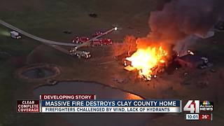 Crews battle large house fire in rural Clay Co. - Video