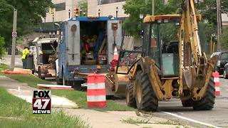 Utility work causes lane reductions in Lansing - Video