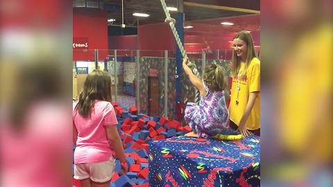 A Tot Girl Falls Into A Foam Pit Face Down