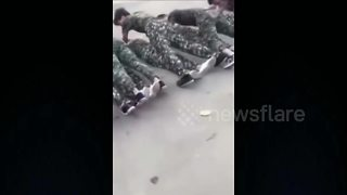 Male students perform push-ups over female classmates