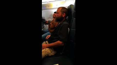 Sleepy Guy Forgets He Is On An Airplane And Lights A Cigarette