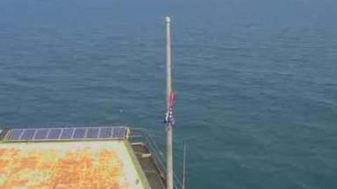 Tattered US Flag Remains on Frying Pan Tower as Camera Turns Back on After Florence