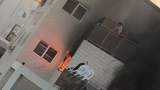 Girl Jumps From Balcony to Escape Fire - Video
