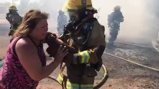 Firefighters rescue dog from north Phoenix house fire - Video