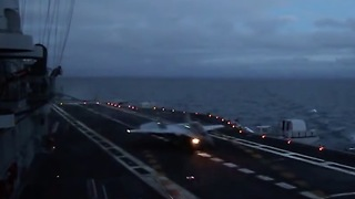 Naval fighter MiG-29K twilight landing to aircraft carrier  - Video