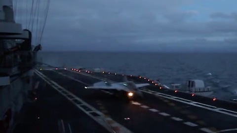Naval fighter MiG-29K twilight landing to aircraft carrier