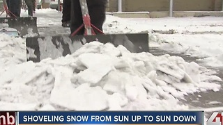 Shoveling snow from sun up to sun down - Video