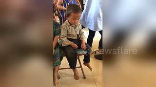 Too cute! Boy can't keep his eyes open after early morning start - Video