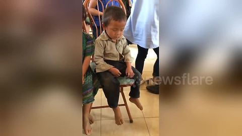 Too cute! Boy can't keep his eyes open after early morning start