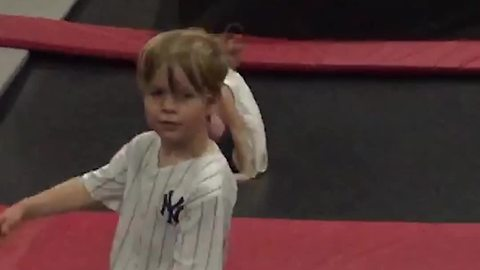 Little Boy Tries To Do Flips on Trampoline But Fail